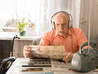old man listening to radio