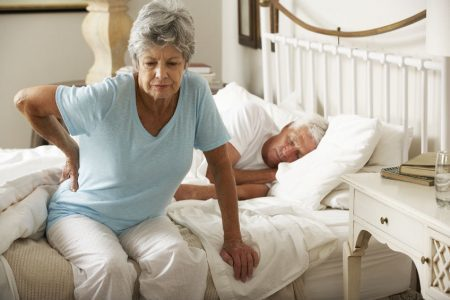 senior woman trying not to fall when getting out of bed