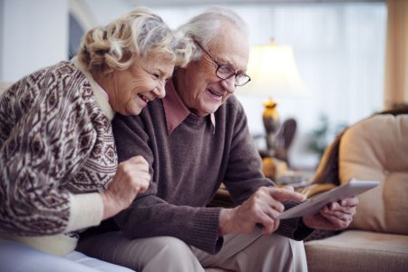 senior couple usng apps on a tablet