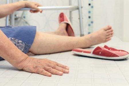 senior woman on bathroom floor after fall