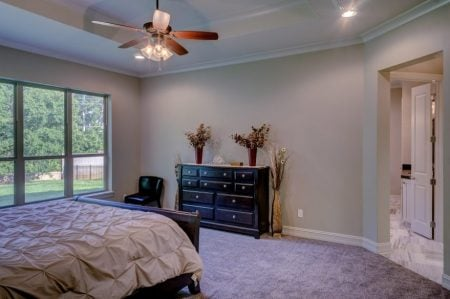 high bed in a big bedroom