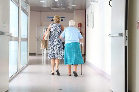 elderly lady walking with cane