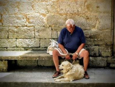 elderly man and his companion dog