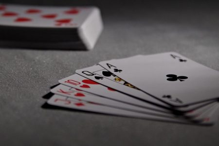 playing cards fanned out on table