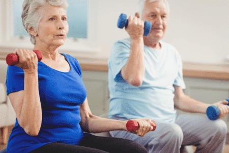 senior women lifting weights in exercise class