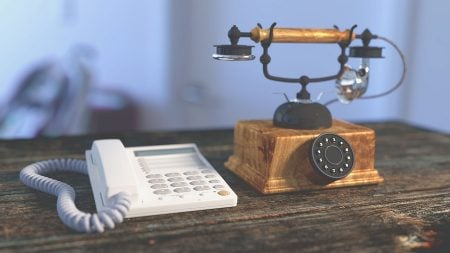 new and old telephone on a desk