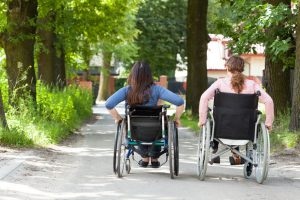 women using 2 different types of manual wheelchairs