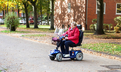 lady riding a mobility scooter