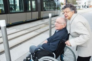 senior couple traveling with a wheelchair