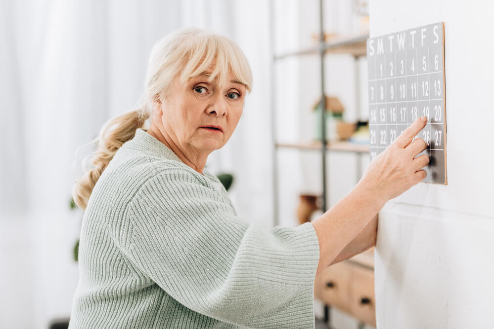 senior with dementia trying to understand her calendar