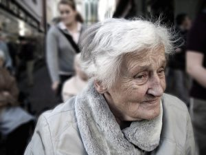 senior woman with dementia looking confused