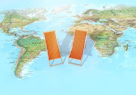 map in background with two beach chairs