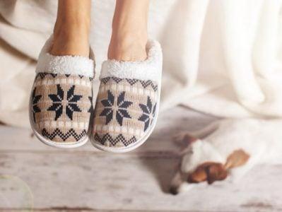 senior woman wearing house shoes