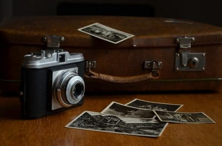 camera with clack and white photo prints