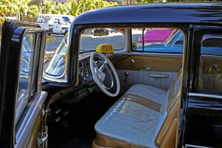 inside of an old car showing the car seats
