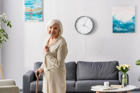 senior standing in front of easy to read clock