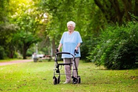 large senior woman using a bariatric rollator