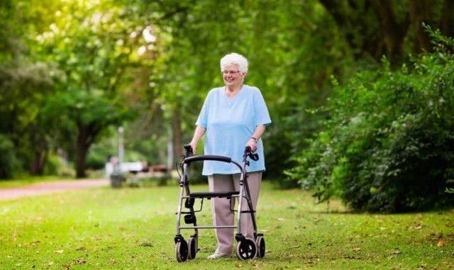 large senior woman using a bariatric rollator