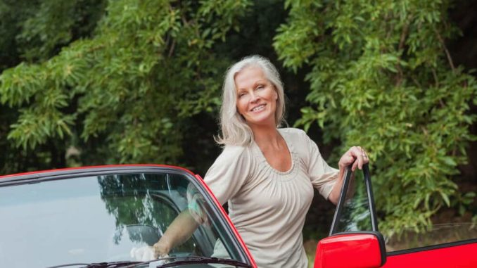 senior woman getting out of her car