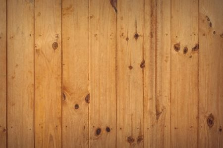 honey colored hardwood flooring with dark knots
