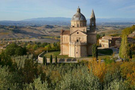 historic spired church on top of an italian mountain