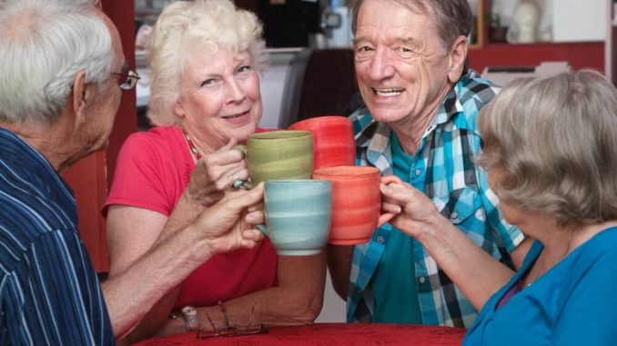 group of seniors drinking from lightweight coffee mugs