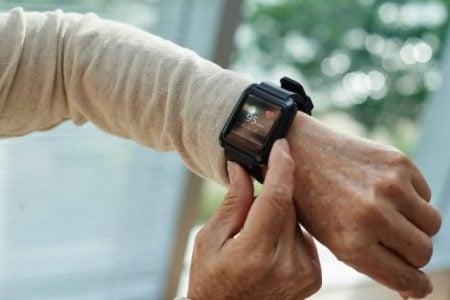 senior woman using her new fitness tracker