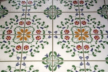 floral patterned vinyl flooring in bright colors on a white background.