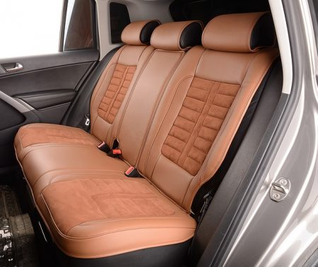 back seat of a car shown through the open car door