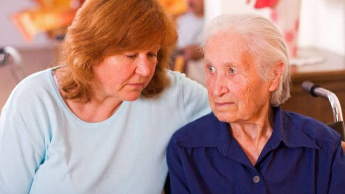 worried daughter because elderly mother talks to herself