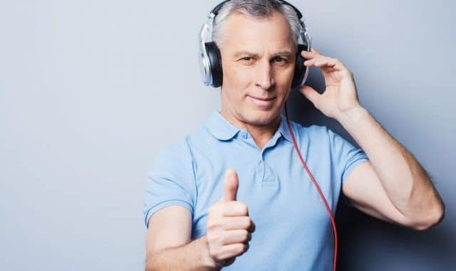 man giving thumbs up to his lightweight headphones for elderly