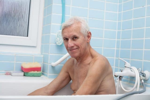 senior man in tub getting ready to bathe