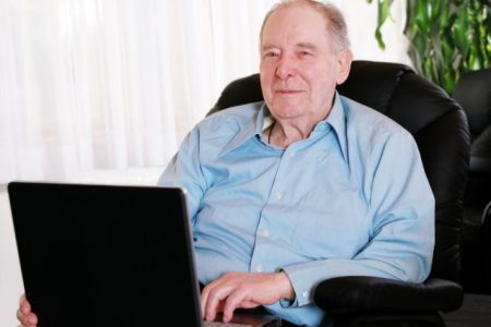 elderly man sitting in a lift chair