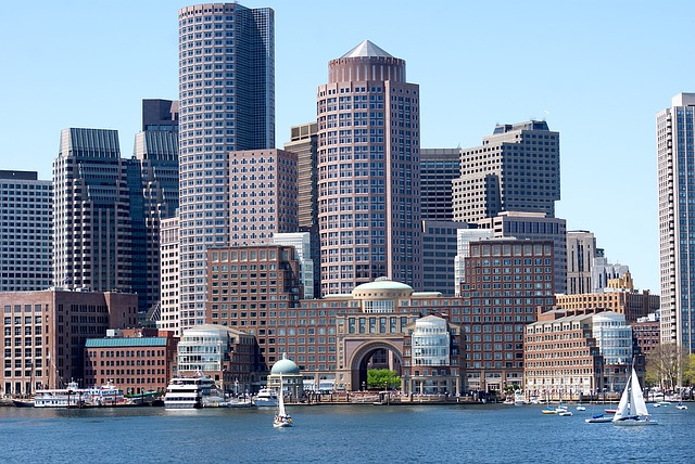 The Boston Massachusetts waterfront with sail boats in the harbor