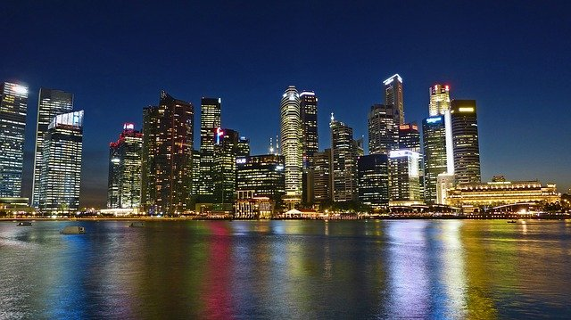 the singapore skyline at night as viewed from the river