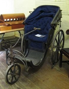 The Bath chair with a steering handle