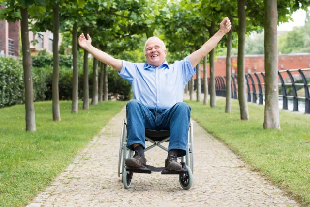 happy man in his new free wheelchair