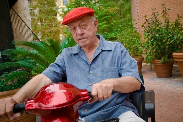 senior man riding a mobility scooter
