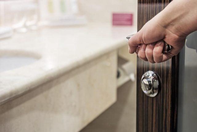 woman opening a narrow bathroom door