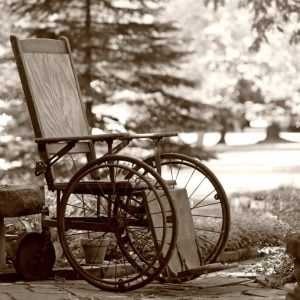 antique wicker and wood wheelchair