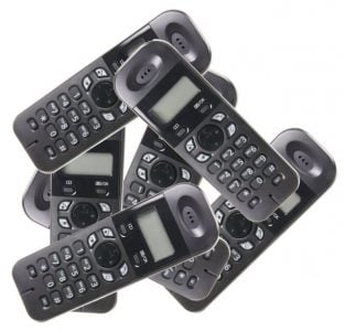 pile of cordless phones on a white background