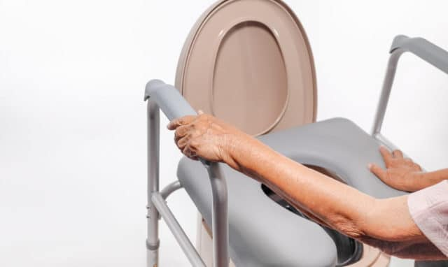 commode chair over an elderly person's toilet