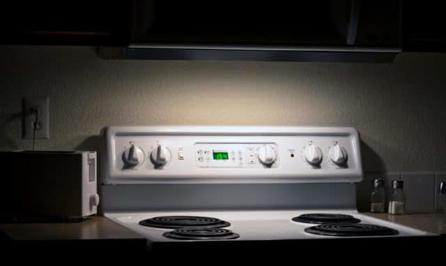 kitchen range hood with light on at night to help prevent falls.