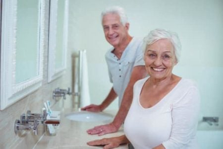 senior couple smiling from their new bathroom accessories for seniors
