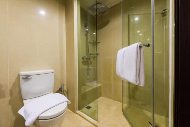 walk in shower with built-in shower seat and handheld shower head