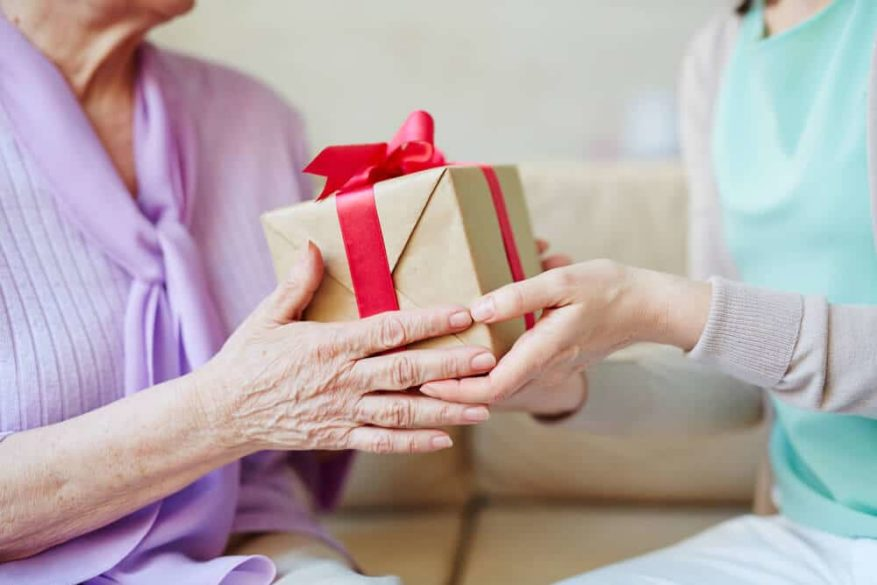 woman giving gift to arthritis suffer