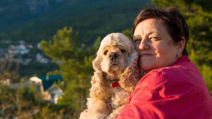 widow senior hugging her dog