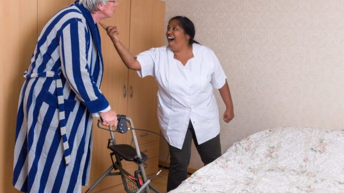 elderly man being yelled at by his nurse