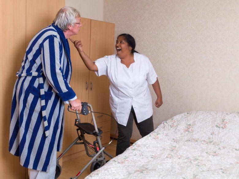 elderly man being yelled at by his nurse