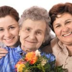 women bringing gift for 80 year old grandma